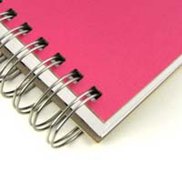 Detailed view of cover and double-spiral binding: Mirage Paper Co.'s enviro-savvy Jumbo ecojot Pink Rethink Notebook makes an excellent gift for tree-huggers!